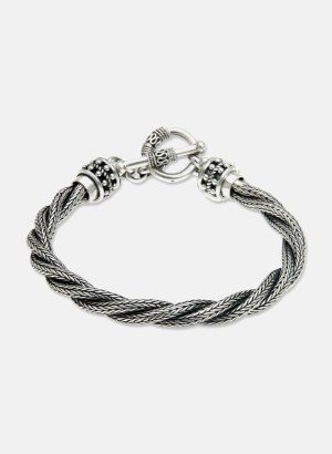 Crafted by hand, this richly textured design features naga chains twisted into a torsade. Putu Putri presents a silver men's bracelet of modern elegance.  .925 Sterling silver