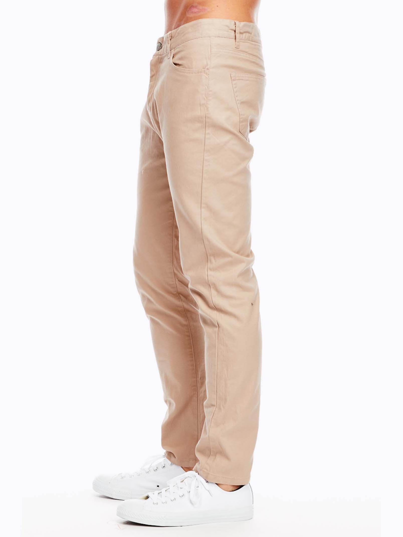 Nudie Jeans Co. brings its jeans-making expertise to these slim-fit khakis. The narrow hip breaks to a straight leg from the knee to the ankle. A touch of stretch for added comfort. 5-pocket styling. Button closure and zip fly. Fabric: Stretch twill. 97% cotton/3% elastane.